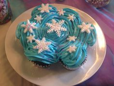 Frozen themed cake just for the birthday girl! Just homemade cupcake with regular icing and fondant snowflakes made with a snowflake impression tool. Inexpensive and perfect for frozen themed birthday party
