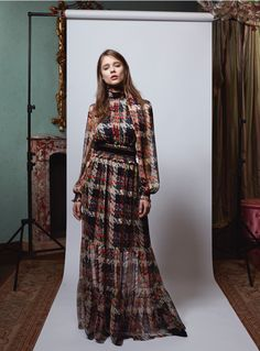 "This is a women's dress designed by Blumarine Pre-Fall 2017. It possesses many of the characteristics of a dress worn by women in the 1900's. The dress has an empire waist with a ribbon to create emphasis on the ""mono-bosom"" look as well as peasant sleeves. The neckline is a high neck and a hem that falls to the floor and has a very minimal train that drags behind. 2.2.17 Leah Schwallie"