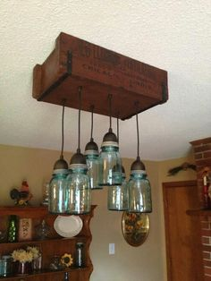 How to Make Canning Jar Lights Think outside the jar to create inexpensive, country-chic lighting fixtures using Ball canning jars. By Gary and Gina Blocker Canning Jar Lights, Ball Canning Jars, Diy Mason Jar Lights, Pot Mason, Mason Jar Lighting, Mason Jar Lamp, Kitchen Lighting, Mason Jar Light Fixture, Mason Jar Chandelier
