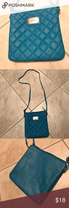 Nine West cross body purse This is a great turquoise purse. Never been worn. Great for a night out where you want to be fashionable and have room for a lot of stuff without the worry of laying your purse down. Nine West Bags Crossbody Bags