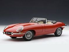 This Jaguar E Type Series I Roadster 3.8 Diecast Model Car is Red and features working steering, suspension, wheels and also opening bonnet with engine, boot, doors. It is made by AUTOart and is 1:18 scale (approx. 24cm / 9.4in long).  ...