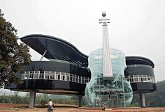This unique piano house was built recently in An Hui Province, China. Inside of the violin is the escalator to the building. The building displays various city plans and development prospects in an effort to draw interest into the recently developed area.