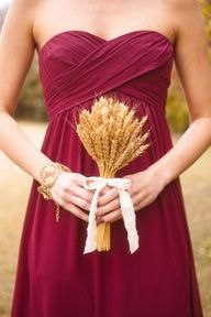 cranberry bridesmaid dress with wheat bouquet - i'm liking this color