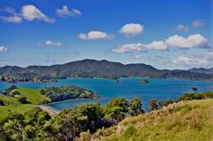 Bay of Islands (New Zealand). 'Turquoise waters lapping in pretty bays, dolphins frolicking at the bows of boats, pods of orcas gliding gracefully by: chances are these are the kind of images that drew you to New Zealand in the first place, and these are exactly the kind of experiences that the Bay of Islands delivers so well.' http://www.lonelyplanet.com/new-zealand/northland-and-the-bay-of-islands/bay-of-islands