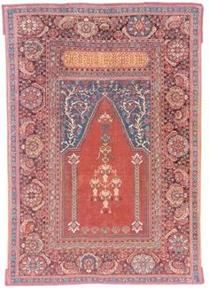 GHIORDES PRAYER RUG WEST ANATOLIA, FIRST HALF 18TH CENTURY Evenly worn, corroded black, scattered light repiling and small spot repairs, selvages replaced, fringes added 5ft.4in. x 3ft.10in. (163cm. x 117cm.)