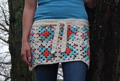 Ravelry: Granny Square Apron pattern by Sara Freisberg.  Makes me want to take up the hook as they say.