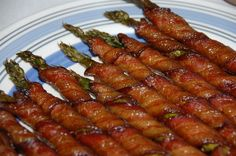 Bacon Wrapped Asperagus  Preheat oven to 400  Divide asparagus into bundes of 3-4 spears  Wrap each in a slice of bacon In a saucepan, melt a stick of butter, 1/2 c. brown sugar, 1Tbspn soy sauce, 1/2tsp garlic salt, and 1/4 tsp black pepper and bring to a boil.  Pour mix over bundles and bake until bacon looks done.  I would slap these bad boys on the grill!!!