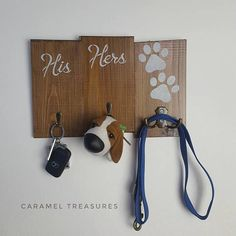 Check out this item in my Etsy shop https://www.etsy.com/listing/527640001/rustic-his-hers-and-dog-paws-wall-key