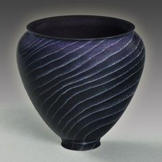Hackberry vase dyed purple and black, with white liming wax in the grain.