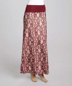 Luxurious length, a comfy waistband and a hint of stretch make this skirt the perfect fit, while entrancing style takes hold with an eye-delighting print.