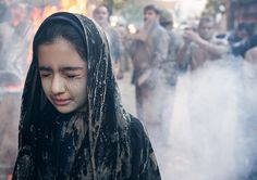 https://flic.kr/p/Nf18kx | An iranian shiite muslim girl with closed eyes stands in front a bonfire after rubbing mud on her chador during the kharrah mali ritual to mark the ashura day, Lorestan province, Khorramabad, Iran | © Eric Lafforgue www.ericlafforgue.com