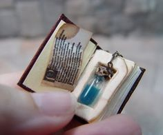 Potions: Miniature book with #potion bottle.