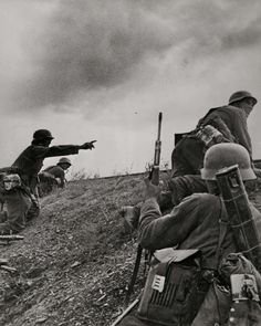 Eastern Front, Sept 1941: German platoon commander reacts to a Russian ambush directing his men to counterattack. Note the soldier closest to the camera carrying a leather sheath for spare barrels for the machine guns. He is also weighed down by what looks like a heavy documents pouch.