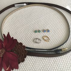 ✨2 Belts, 4 Earring Bundle✨ Belts are from Loft and Ann Taylor NWT. Earrings are gently used. The colored stones are great for summer and the hoops in silver and gold are timeless. I think the hoops are monet, and the stones are from a boutique. One belt is navy and the other has a leather flower! Ann Taylor and LOFT Accessories