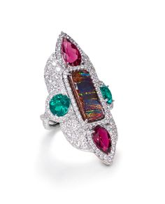 Striated Boulder Opal with Rubellites and Emeralds with White Diamond Pave mounted in platinum. LEVIEV