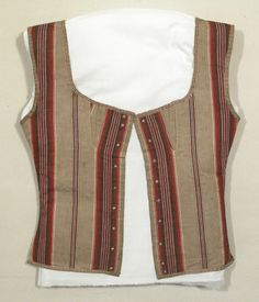 Corset bodice - Made from red, brown, cream and blue striped cotton ticking. It is trimmed an all edges except the centre front with cream and brown cotton tape. it fastens with 9 pairs of eyelet holes centre front. (female)