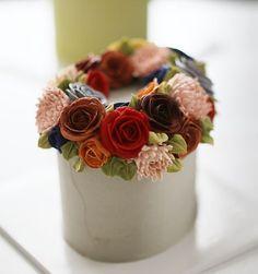 Thailand student's work... wreath style buttercream flower cake. .. #buttercream…