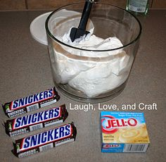 this is my staple when attending picnics or pot-lucks.  I make mine a little differently than most-- (for a double batch:) 8 diced apples (I take the skin off mine.) 8 Snickers cut up 16 oz Cool Whip 1 1/2 cups milk 2 small boxes of Instant Pudding (I use 1 vanilla & 1 banana cream)  Mix milk with pudding, fold in Cool whip, and then finally add the apples and Snickers! Refrigerate.