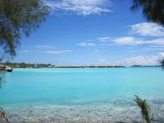 Look at all that amazing blue! Bora Bora island in French Polynesia is a true paradise on earth. A popular place to honeymoon and vacation.   boraboraphotos.com
