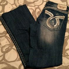 """Big Star """"Liv"""" Jeans Big Star """"Liv"""" Boot Jeans. Tag reads 29xxl but inseam is really 33"""" long. Cut bottoms to have a frayed bottom. Awesome silver metallic leather on back pockets and through threading! Big Star Jeans Boot Cut"""