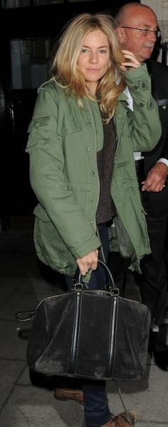 Who made Sienna Miller's black handbag and green jacket that she wore in London on March 28, 2011?