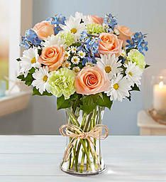 Summer Dunes | 1800Flowers.com | Calling to mind a cloudless day along the coast—with sand dunes gently shifting in the breeze—our beach-inspired bouquet is hand-arranged using the freshest roses, carnations, daisy poms and delphinium gathered together into a clear glass vase. Send this delightful surprise to someone you care about and help them celebrate the carefree beauty of summer!