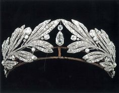 c.1907.  The Cartier diamond and platinum laurel leaf tiara that belonged to Princess Marie Bonaparte, who became Princess George of Greece. This tiara can be worn with or without the centre diamond drop.