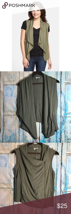 """Halogen Olive Army Green  Drape Front Knit Vest A go-to layering piece plays it soft and easy in a silky stretch-modal knit with a draped, asymmetrical-zip front to wear open.  Features:  - 95% modal, 5% spandex - Machine wash cold, tumble dry low  Approximate measurements: bust: 38"""" length: 21"""" Large=12-14  Condition: Very good pre-owned condition, no visible flaws. Halogen Jackets & Coats Vests"""