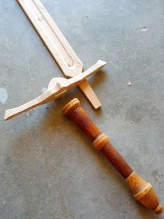 Wooden sword-- interesting way of attaching the guard and handle to the blade
