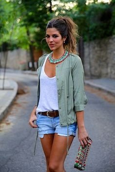 Shop this look on Lookastic:  https://lookastic.com/women/looks/anorak-tank-shorts-clutch-belt-necklace/11788  — Mint Necklace  — White Tank  — Grey Anorak  — Dark Brown Leather Belt  — Light Blue Ripped Denim Shorts  — Multi colored Clutch