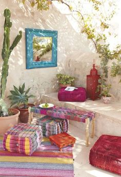 The colors are so gorgeous in this boho inspired patio area.