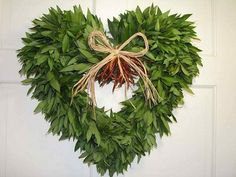 I'm thinkin cover a heart shaped wreath with some silk greenery