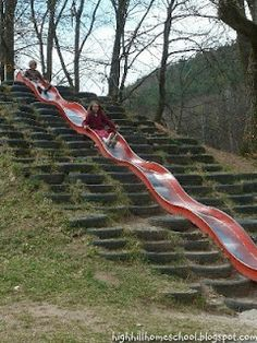 Slide built into a hill with seating - nice way to integrate play elements into the environment *** Barenloch Park in Kindsbach