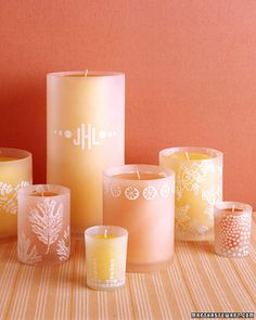 Stamped Glass Candleholders: re-create the beauty of etching with ease. All you need is a rubber stamp, white ink, and glass candleholders -- frosted glass holds ink best. One stamp can form a single motif or an allover pattern. (For a custom design, such as your monogram, have a stamp made at an office-supply store.) To use a large stamp on a cylindrical container, carefully roll it from side to side. Allow a day or two for ink to fully dry. (found here…