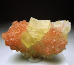 Rockhound Revival: Yellow cubes of Fluorite atop of red druzy Quartz...