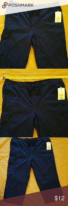 NWT navy blue capris Thes have been sitting in my dresser since spring. Jusst trying to recoup my money.   Stretchy waistband.  Pockets at hips and side of legs. White Stag Pants Capris