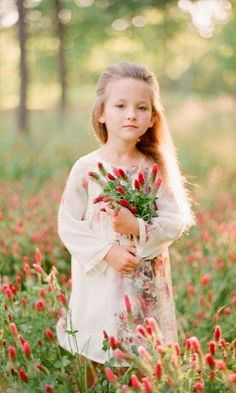 """""""And when I looked out into the field, away from the grey rock bearing her name. I could almost see her, standing in the sunlight, the red flowers of the field gathered in her arms. It was then I knew: I believe in angels."""""""