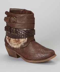Loving this Brown Austin Boot: DIY version: me, 4 belts, cowboy boots, fake fur, scissors and hot glue. Bringing the awesome