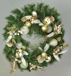 Artificial Christmas Wreath - 18'' by Gordon Companies, Inc. $64.50. Please refer to SKU# ATR25757258 when you inquire.. Brand Name: Gordon Companies, Inc Mfg#: 30659764. Shipping Weight: 4.00 lbs. Picture may wrongfully represent. Please read title and description thoroughly.. This product may be prohibited inbound shipment to your destination.. Artificial Christmas wreath/pre-decorated/gold theme/not lit/sturdy metal frame/18'' dia./6'' deep/made of PVC, plastic, wire...