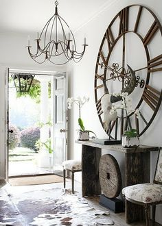 chandelier in entryway, table and wow piece of art