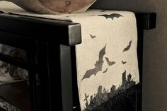 Halloween theme table runner... gives me ideas for many table runners using burlap and stencils