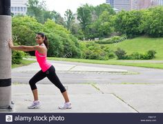 http://c8.alamy.com/comp/FBX71F/young-woman-stretches-before-running-FBX71F.jpg