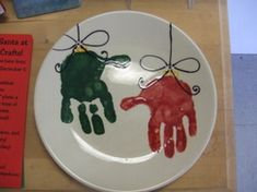 Handprint ornament plate. I need to do this next year and put both Ella and Riker's hands on the plate.