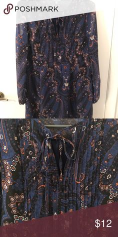 Navy Blue Paisley Dress Never worn! Size 0 fits like a 2 or size Small, it is loose fitting. Navy blue dress with paisley print. Boho/peasant style but clean cut enough for the office too. Sleeves are sheer, dress has slip attached underneath with sheer overlay. Hits above the knee. Dresses