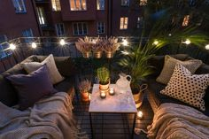 Make the most of your outdoor space, no matter how big or small. This cosy balcony is ideal with festoon lights. Make the most of your outdoor space, no matter how big or small. This cosy balcony is ideal with festoon lights.
