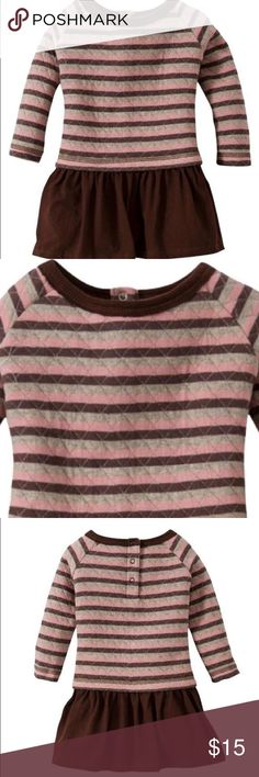 Burts Bees Baby Girls Quilted Striped Pink Dress This dress mimics a top and skirt, but it's a dress. Talk about an easy outfit! Made of 100% organic cotton, the Burts Bees Baby Toddler Girls' Quilted Striped Top Dress is cozy, comfortable and cute. It's pullover style with 3 buttons at the back of the neck. This dress is machine washable and dryer safe for easy care. New with tags. Burt's Bees Dresses
