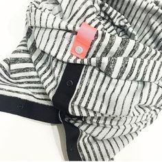 Lululemon vinyasa scarf Grey and white stripe, black outline, pink tag, worn once! Perfect condition, soft cotton fabric lululemon athletica Accessories Scarves & Wraps
