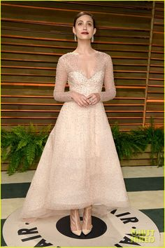 Emmy Rossum at the 2014 Vanity Fair Oscar Party hosted by Graydon Carter held during the 2014 Oscars on Sunday night (March 2) in West Hollywood, Calif. Emmy is wearing Monique Lhuillier dress and shoes paired with jewelry by Chopard.