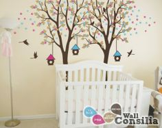In Stock $124.00 www.wallconsilia.com  Cute and dreamy tree decal with stunning vibrant colors and cute birdhouses, great addition to your baby's room. Indulge your little one's imagination with this stunning vinyl wall decal set perfect for any nursery or bedroom. We think it's a great choice for gender neutral nursery! This tree mural sticker features dreamy scene –what could a little kid love more?  #DIY #HomeDecor ##Trees #Birds #BirdCages #Unisex