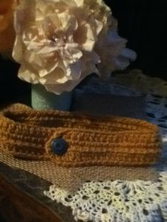 Brown headband with vintage button.